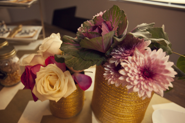 Gold burlap wrapped Cans serve as vases