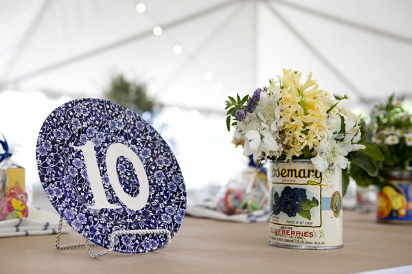 Hand stenciled table numbers on mismatched china. Photo by Leah Lee.