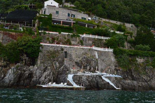 From our boat: The view of Palazzo Avino's Clubhouse by the Sea carved into the rocks.
