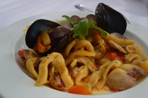 Linguini with an assortment of fresh fish…. clams, mussels, calamari. Heaven!