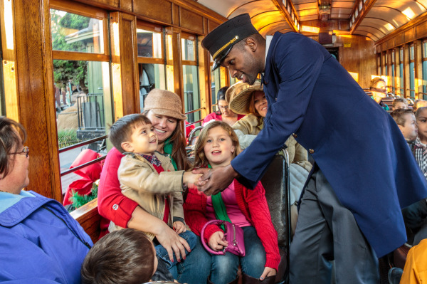 Boy shaking hand of conductor